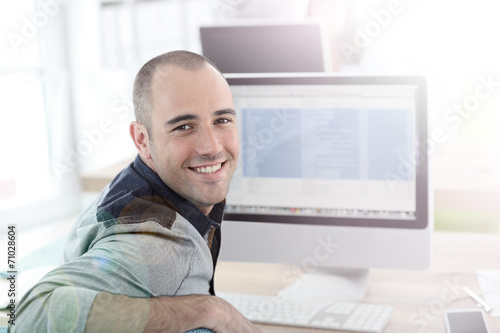 canvas print picture Portrait of student in front of desktop computer
