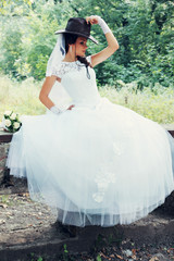 pretty bride in a cowboy hat, tinted
