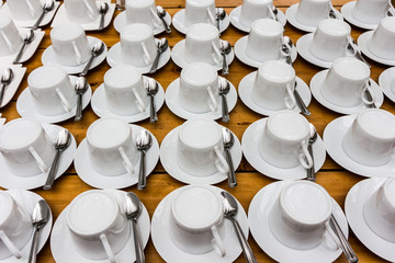 Many rows of pure white cup of coffee and saucer