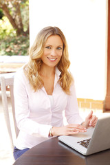 Middle age businesswoman with computer