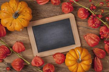 Orange pumpkins and physalis