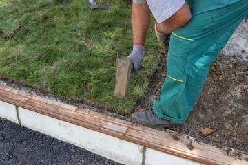 Worker installing sod