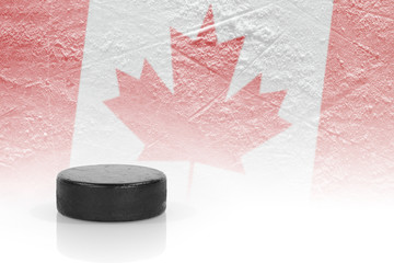 Hockey puck and a Canadian flag