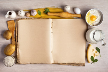vintage cook book and ingredients for the food recipe around in