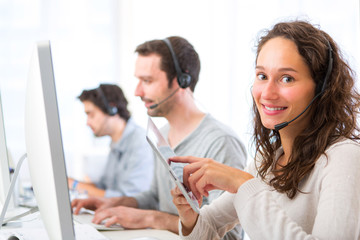 Young attractive woman working in a call center