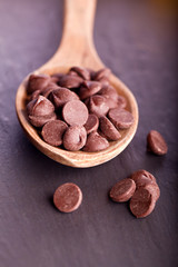 choclate chip morsels on wooden spoon