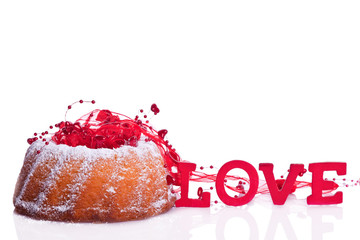 bundt cake with sweet raspberry and love sign