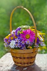 chrysanthemum bouquet in a basket