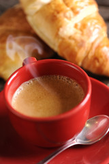 Croissants and coffee on wooden table