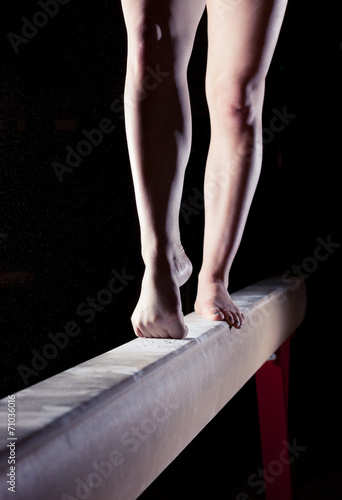 Poster feet of gymnast on balance beam