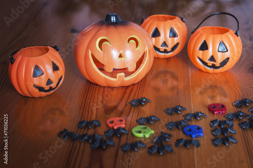 canvas print picture Halloween pumpkins on wooden with spider and skulls