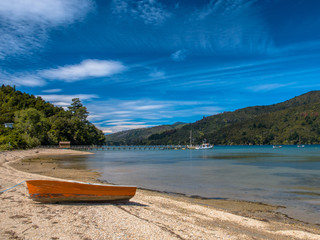 Boat on the Shore of a Fiord in Marlborough Sounds, South Island