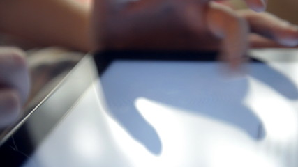 Using tablet computer close up