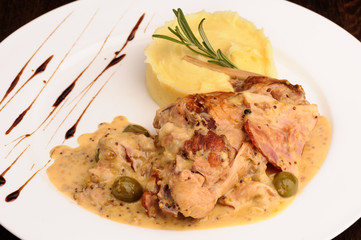 Rabbit legs with potato puree and rosemary