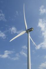 Wind generator under blue sky