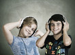 boy and girl with headphones listening to music