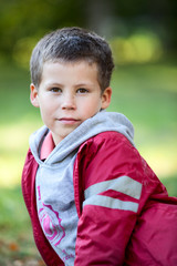 Portrait of a six year old Caucasian boy in a red jacket