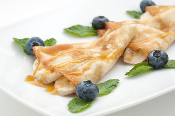 Pancake with blueberry isolated on white