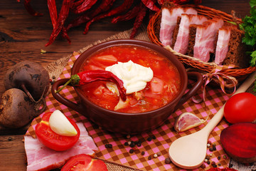 The national Ukrainian borscht on the old wooden background