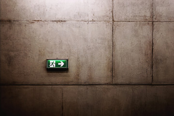 green exit sign on the wall