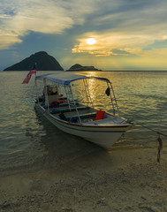 Boat with sunset background