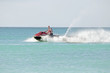 Young guy cruising on the caribbean sea on a jet ski - 71042291