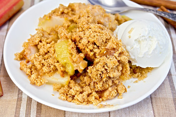 Crumble with rhubarb in dish on linen tablecloth