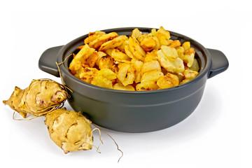 Jerusalem artichokes roasted in pan