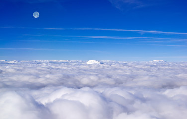 Panorama of clouds and moon from plane
