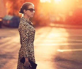 Street fashion, stylish woman in a dress with leopard print