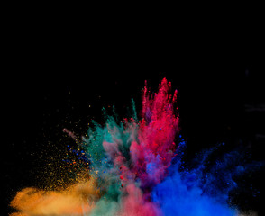 colored dust explosion on black background