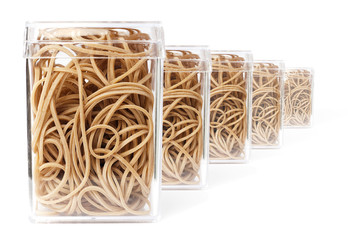 Five boxes with elastic rubber bands in a row