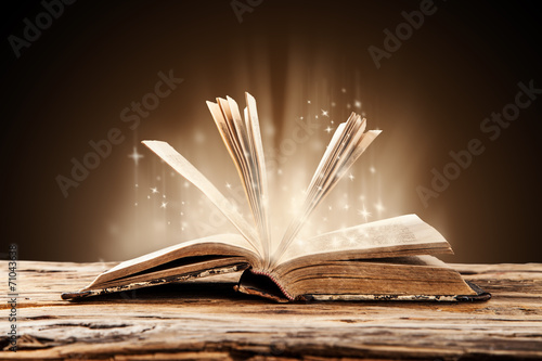 Old book on wooden table - 71043638