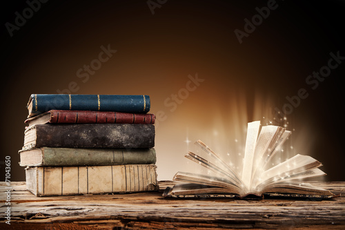 Old books on wooden table - 71043650
