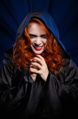 Witch on blue rays background