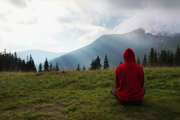 man meditating in the mountains