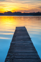 Beautiful Sunset over Wooden Jetty in Groningen, Netherlands