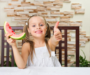 Little smiling girl with watermelon