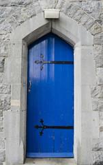Blue door in limestone wall