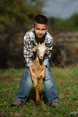 cute little boy with goat