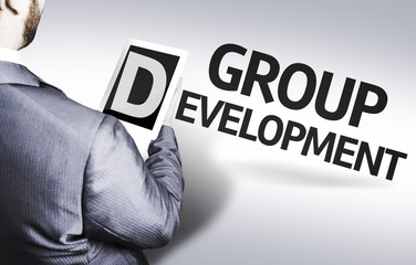 Business man with the text Group Development in a concept image