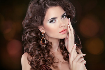 Beautiful attractive brunette woman model with wavy long hair an