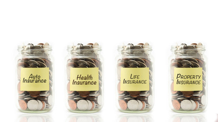 Isolated coins in jar with insurance concept