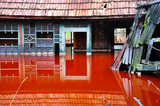 A house flooded by industrial mining water