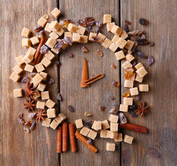 Brown sugar cubes and spices in shape of clock