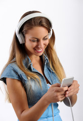 Young girl listening to music on an MP3 player