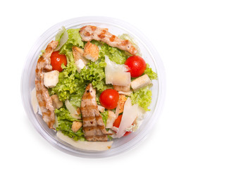 Caesar salad with grilled chicken meat, top view