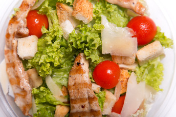 Delicious Caesar salad with grilled chicken meat