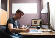 Постер, плакат: Freelance developer or designer working at home