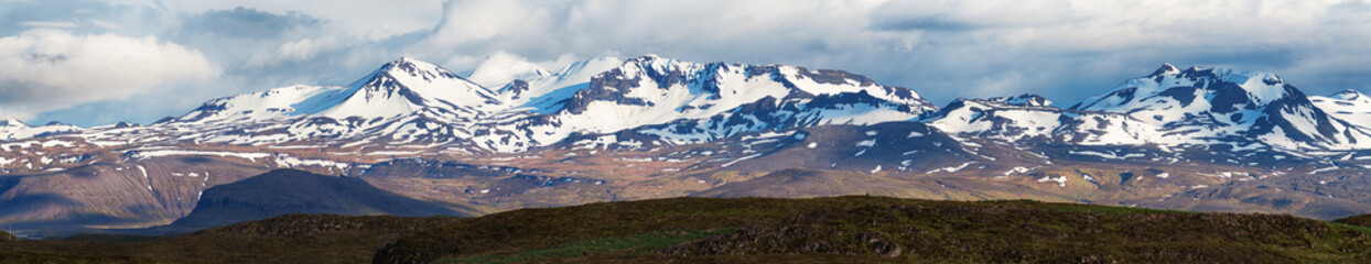Panorama of snow clad mountains in Iceland.